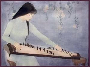 Người ngồi chơi đàn tranh.